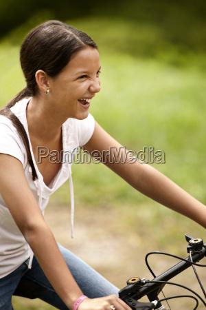 girl enjoying riding her bicycle