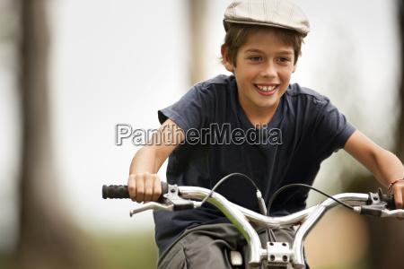 boy enjoys riding his bicycle