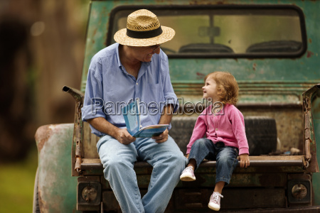 little girl looking at picture book