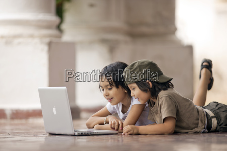 brother and sister looking at a