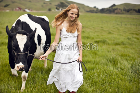 teenage girl standing on the farm