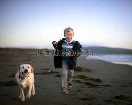 boy and his dog run around