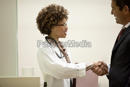 female doctor shaking hands with a