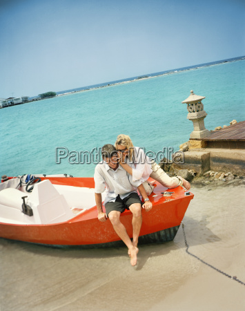 smiling mid adult couple sitting on