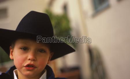 boy with black cowboy hat