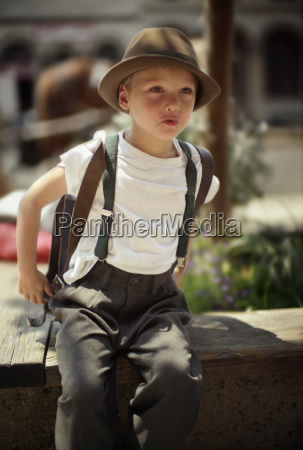 boy in hat and suspenders
