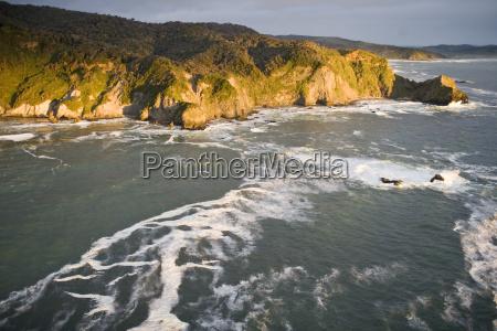sea crashing against bottom of cliffs