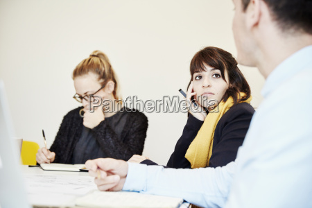 three people seated at a business
