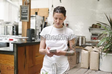 woman wearing a white apron standing