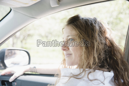 woman seated in the front seat