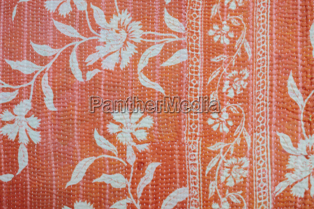 close up of a fabric bedspread