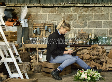 commercial florist a woman sitting on