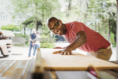 man wearing glasses working in a