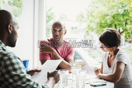 two men and a woman sitting