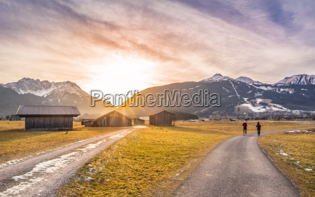 winter sunset over alpine country roads