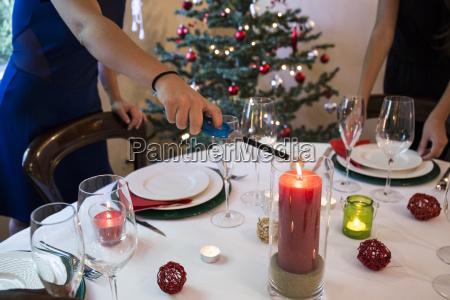 woman lighting a candle on christmas