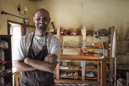 portrait of smiling luthier in his
