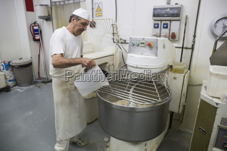 baker pouring water in an industrial