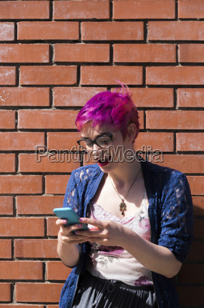amazed young woman with dyed hair