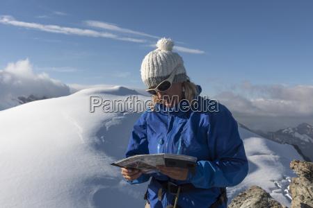 switzerland woman looking at map at