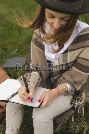 young woman sitting on a meadow
