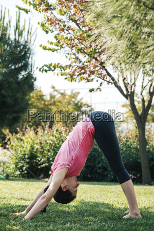 young woman practicing yoga in the