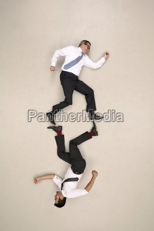 two symmetric businessmen on the move