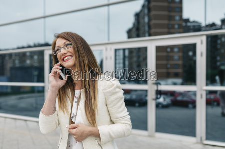 happy businesswoman on cell phone in