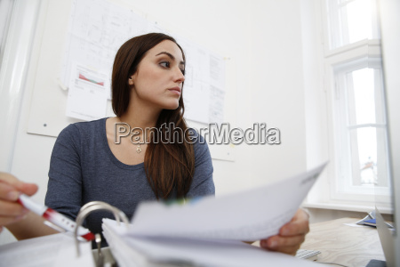 woman working on files at office