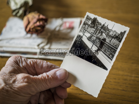 old woman holding picture of her