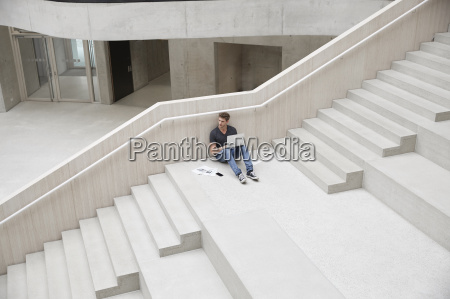 young man sitting on stairs in