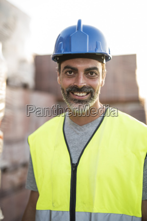 construction worker standing in front of