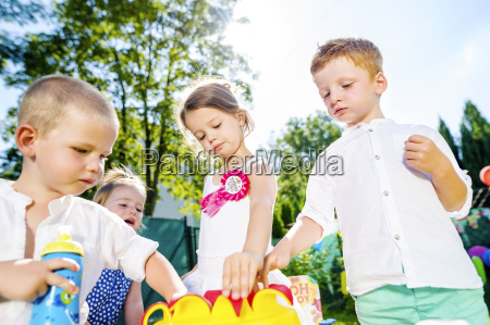 children having birthday party in the