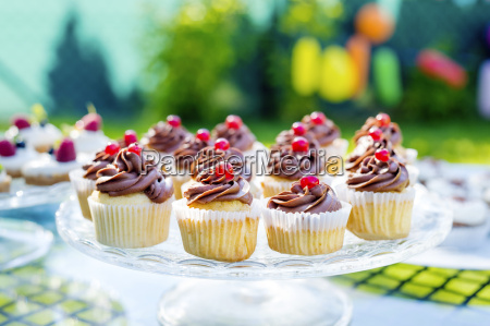 cup cakes on cake stand at