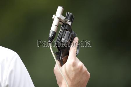starter holding pistol