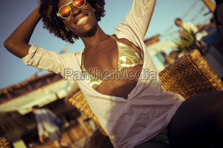 smiling young woman at a beach