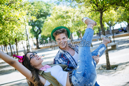 young couple having fun with party