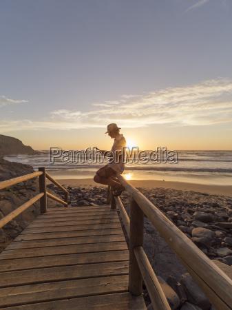 portugal senior man sitting on railing