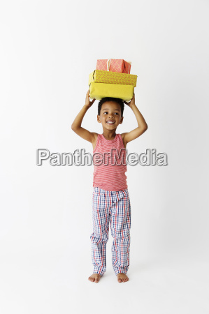 portrait of smiling little boy carrying