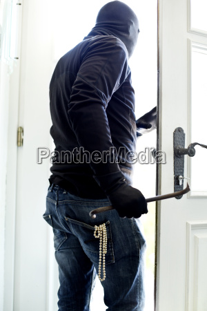 burglar with pearl necklace in pocket
