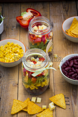 tex mex salad in glasses and