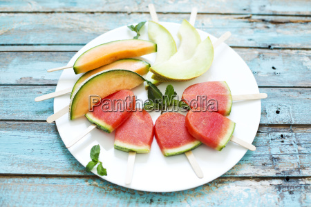 plate of homemade watermelon ice lollies