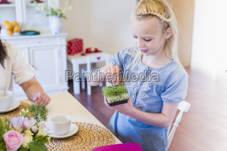 girl at dining table with cress