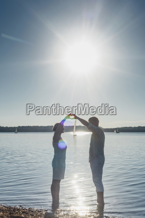 couple standing at lake cospuden forming