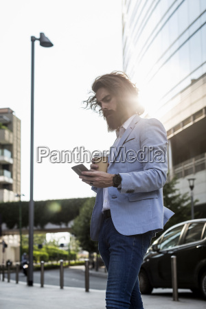stylish businessman with cell phone and
