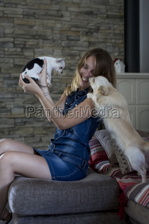 smiling woman with her dogs at