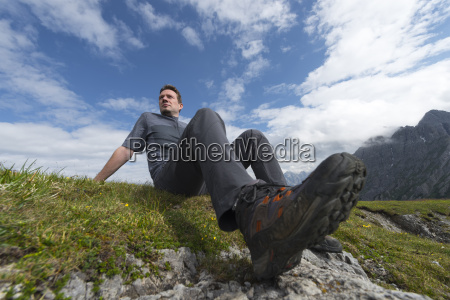 austria tyrol hiker sitting hiking shoe