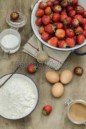 preparation pancake with strawberries eggs flour
