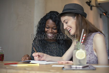 two young women learning together in