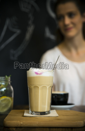 glass of milk coffee on table